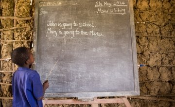 An SLMB Masaba Primary School pupil engages in Literacy, Kunike Barina in Tonkolili, Sierra Leone, 2014. Photo: Michael Duff / Concern Worldwide.