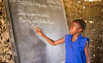 A pupil at SLMB Masaba Primary School, Kunike Barina Chiefdom in Tonkolili, Sierra Leone, engages in a literacy class, 2014. Photo: Michael Duff / Concern Worldwide.