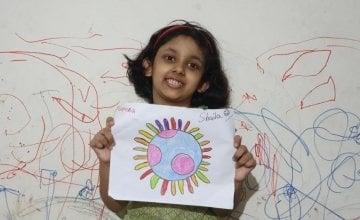 7-year-old Shalia with her artwork, Bangladesh.