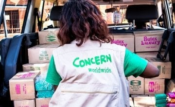 Concern employee Judith Cent distributing soap in Malawi.