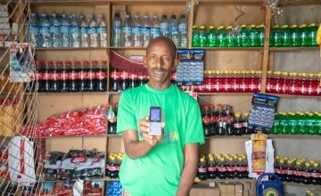 Roble Barkad is a shop owner in Somalia. He accepts cash transfers in his shop. Photo: Gavin Douglas
