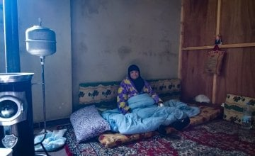 Esma sits in her garage home in Northern Lebanon