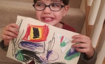 Six-year-old Darragh from Northern Ireland with his drawing of what he wants to be when he grows up.