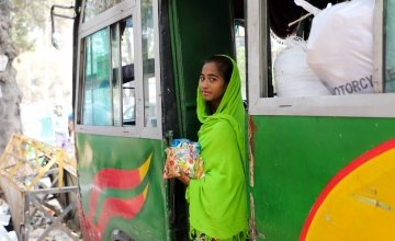 Sakuma* sells sweets and chocolates on crowded buses in Dhaka to save money for her brother's education. Sakuma* (14) and her brother Kassim* are supported by a Concern run pavement dweller center, Ananda Bazar, Dhaka. Having lived on the street most of her life, she lost her mother to illness and her father was a drug addict when a worker from the pavement dweller center found her. They both now live in the pavement dweller center and receive a host of supports from Concern including shelter, food, educati