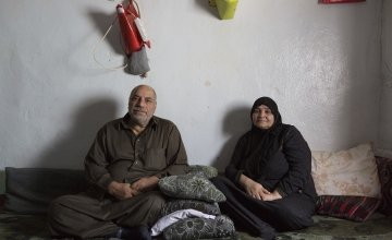 Khaled and Fatima, Syrian refugees, in their home in Lebanon