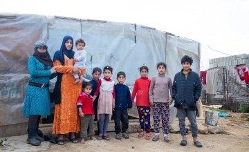 Ghazal* with her children and extended family. Photo: Gavin Douglas
