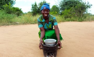Jennifer has been able to cook more efficiently and hygienically for her five children in Malawi. Photo: Jason Kennedy