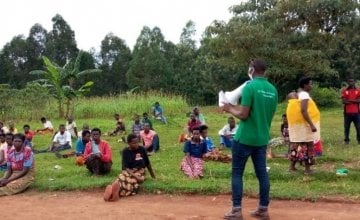 Gilbert Reberaho delivers awareness sessions on Covid-19 prior to distributing face masks, Rwanda Photo: Gaspard Uwumukiza