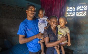 Rosette holds her son John Kelly, with husband Pierre and son Isaac. Photo: Dieu Nalio Chery / Concern Worldwide / Haiti (2021)