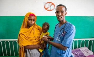 Mother Munira (28) with her 18 month old daughter Malika being seen by a Banadir Hospital Doctor. Malika became malnourished from acute diarrhoea.  Photo: Gavin Douglas/Concern Worldwide
