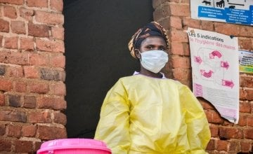 Lwanzo, a health worker from Lukanga, dresses to set an example of what to wear to isolate an infectious disease patient.  Photo: Esdras Tsongo/Concern Worldwide