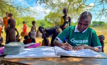 Concern Nurse Beatrice fills detail in the records book at an outreach centre in Kenya. Photo: Jennifer Nolan