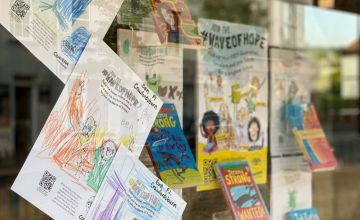 WaveofHope posters line Concern's bookshop window in Holywood, decorated by local primary school pupils. I