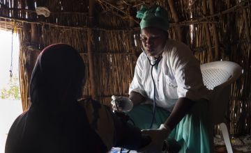 midwife examines a pregnant woman