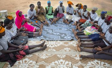 Women in a Mother's Group in South Sudan sit around in a circle