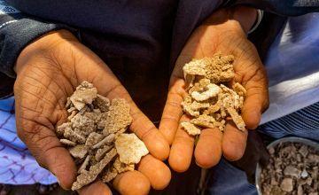 Two hands hold desert salt