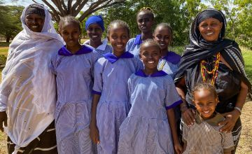 Women from the Chalbi Salt Self-Help Group with girls they have supported to stay in school