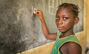 10-year-old Sally in class at a primary school in Sierra Leone. Photo: Michael Duff
