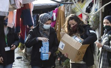 Team members of Concern distribute soap at an informal tented settlement in north Lebanon. Photo: Dalia Khamissy
