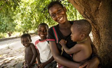 Therese Monga, 24, a beneficiary of Concern Worldwide's Food for Peace program in Kapotongo village, Manono Territory, is seen with her children Peter (baby), Olie, (7), and Jeanine (3).