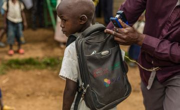BARAKA MBAYO, 5 years old, in primary school in RUBONA, BIRABIZO washes his hands before entering the classroom after going to the toilet. Photo: Pamela Tulizo/Panos/Concern Worldwide