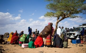 Children and their mothers congregate around a tree used as a focal point for an outreach programme. Photo: Concern Worldwide.
