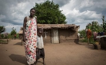 Ayen Duot, 40 years old, with her son Bul Athian in Adjumani, Uganda. Ayen and her children fled Blor, the capital of Jonglei State in South Sudan and now live in a refugee settlement in Uganda. Photo: Panos Pictures / Concern Worldwide.