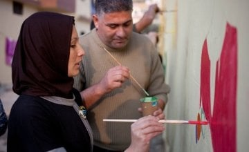 Tarek and Zeinah attend an art workshop with refugee families at a Concern supported Collective Centre in Northern Lebanon in December 2015. Zeinah and Tarek now live with their three children and two other families. Photo: Panos Pictures/Concern Worldwid