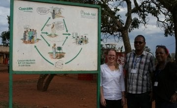 Jenny Swatton Claver Kubuhungu and Felicite Ndikiyuro at the CRM sign. Photographer: Rosaleen Martin