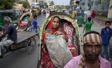 Nazma returns from selling food at local offices in Dhaka, Bangladesh. Photo: Abbie Trayler-Smith / Concern Worldwide.