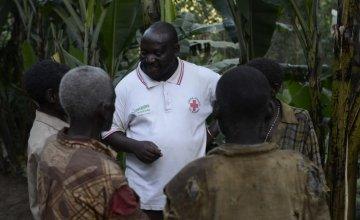 Concern Project Supervisor Joseph Nkengurukiyimana talks to members of the marginalised Batwa community outside their homes on a remote hillside of Kabere, Mabayi, Cibitoke, Burundi.