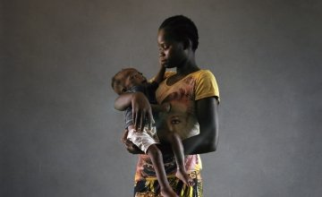 Elianna holds her daughter Laureine at Bossembele hospital. Laureine is 21 months old and severely malnourished. Concern organised transportation from her village to the hospital – the cost of which would be too high for most people.  Metadata report