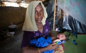 """Shaju (name changed for security) with her day-old daughter in her shelter at Moynardhona refugee camp, Cox's Bazar. She says: """"In Myanmar there was killing and fighting - here there is peace."""" Photo: Kieran McConville/Concern Worldwide."""