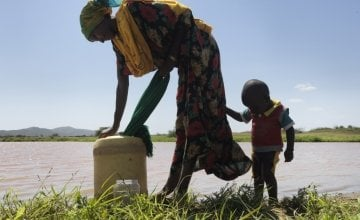 25-year-old Rufo Galgallo and her son 18-month-old Nura collect water twice daily from a nearby dam. The mother-of-three receives advice on good hygiene and a regular supply of water purification tablets from a Concern-supported community outreach program