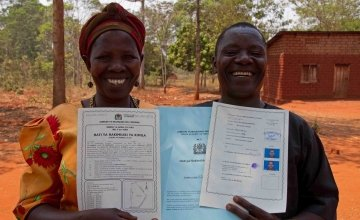 Thomas Vincent Maylinga (53) and Kaleta Sharaba Kabika (47) with their joint land certificate, Kigoma Region, Tanzania. Photo: Jennifer O'Gorman/Concern Worldwide.