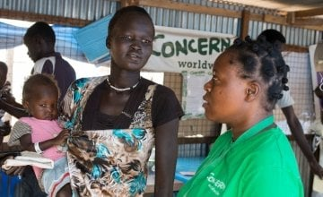Nyakong Kwach and her 12 month old daughter, Nyadhabitat, talk with Concern nutritionist, Tracy Dube at the Concern nutrition centre in a refugee camp in Juba, South Sudan. They took shelter here after fighting broke out in July 2016.