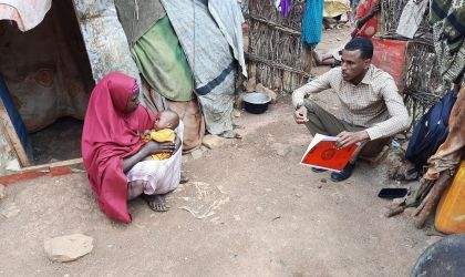 Graduation Caseworker Ibrahim Abdi Ali visiting Fahima* and her son Abdirizak* in their household in Baidoa. Photo: Hassan Isgoowe Molsmed. (*pseudonyms to protect their identities).