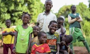 Three of Natalie Wato's children - Davilla, Patricia and Gaus with their friends from the village of Gbatin. Photographer: Darren Vaughan