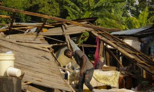 A man search goods in his destroyed house after a magnitude 7.2 earthquake in Manich, Les Cayes. Photo: Lucien Junior Telasmond