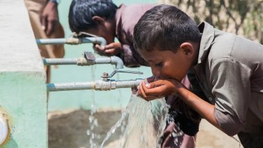 Children from Satla Bheel village enjoy drinking water from the water plant system installed by Concern. Pakistan. Photo: Black Box Sounds/Concern Worldwide