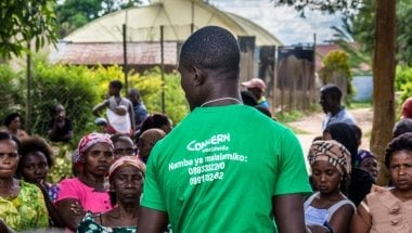 A Concern agent checks the names of IDPs who have been registered to receive assistance in Oicha.  Photo: Esdras Tsongo