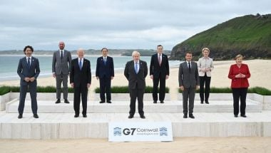 World leaders stand together at the G7