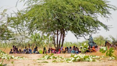 Families take shade for the harsh sun as they wait to be seen by doctors at a Concern mobile clinic in the Lake Chad region. Some of these families walk for hours to reach healthcare. Concern are the only NGO providing these services in the region. Photo: Gavin Douglas/Concern Worldwide