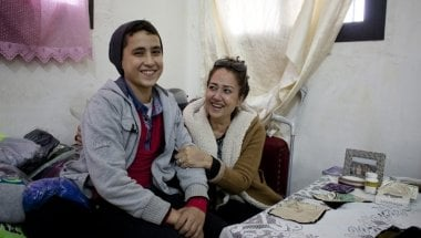 Rabia, a member of the Concern-funded sewing workshop in Tripoli, Lebanon, with her son. Credit: Abbie Traylor-Smith/Panos for Concern Worldwide