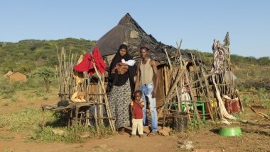 20-year-old Fatuma Mohamed and husband Abdulahi Osman (25) with their two boys - Yusuf, who is only three-and-a-half weeks old, and Mohamed (2½). Photographer: Peter Caton