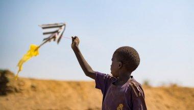A child flies a home-made kite in a PoC camp in Juba, South Sudan. Photo: Steve De Neef / Concern Worldwide.
