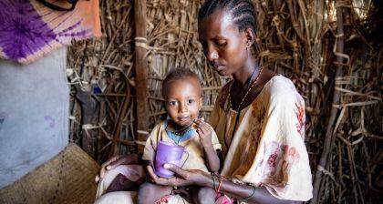 Marin with baby Peter in Kenya. Photo: Ed Ram