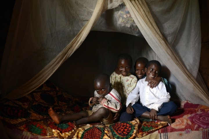 One of the few households with a mosquito net in the bedroom where children, Salomon (3), David (6), Issa (10) and Selemani (13) sleep. Photo: Chris de Bode/Panos Pictures for Concern Worldwide