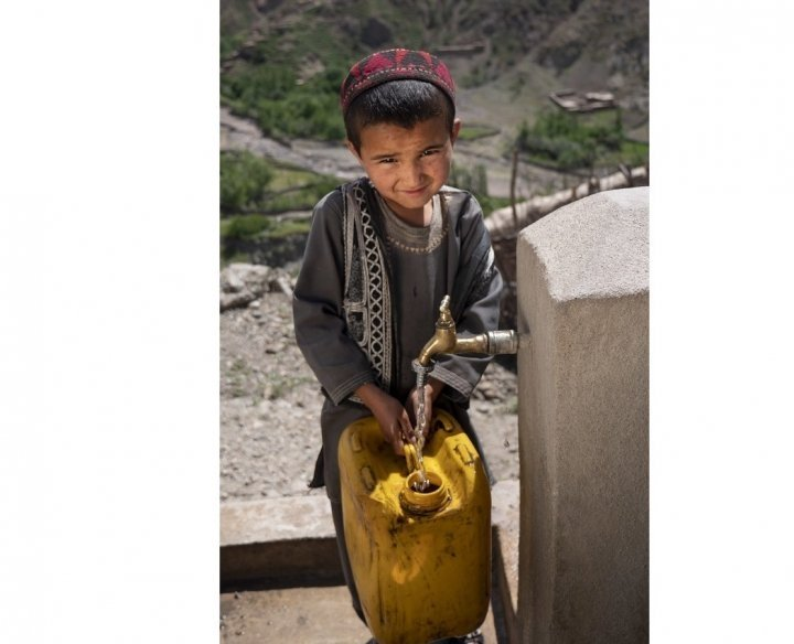 Boosah*, from Namakab, Afghanistan can now collect water in the safety of her village – saving her hours of walking to and from the river. Photo: Kieran McConville / Concern Worldwide