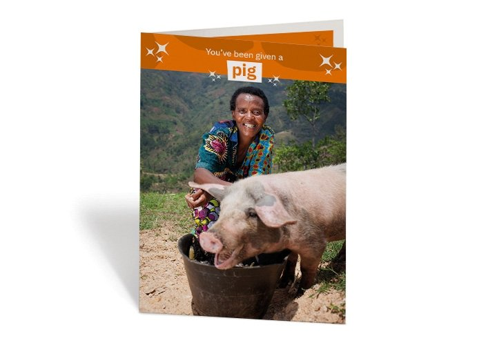 Violette Bukeyeneza, 45, and her son Lievain, 3 with their life-changing pig at their home in Cibitoke, Burundi. Photo: Abbie Trayler-Smith/Concern Worldwide